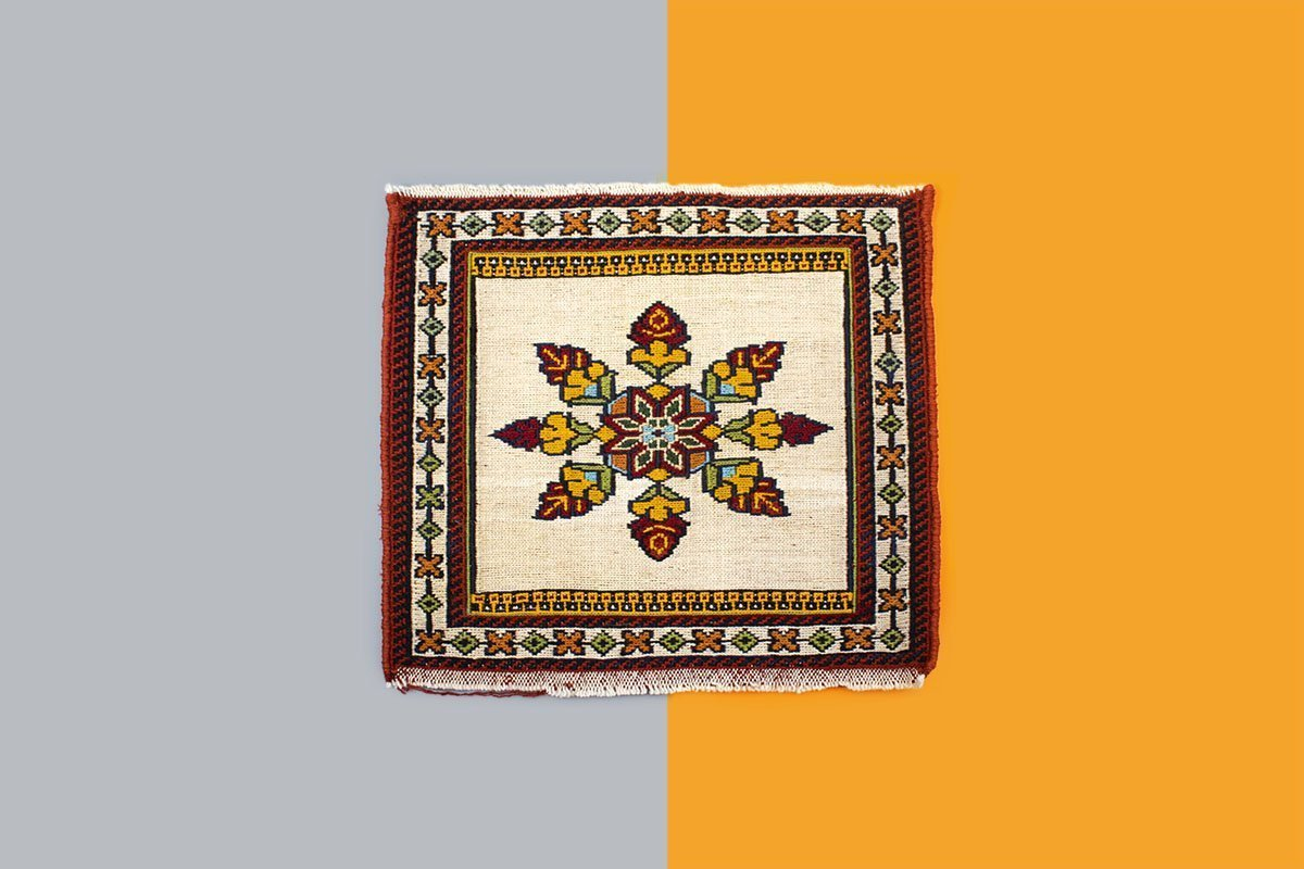 The Miniature Persian Kilim Is Hand Knotted Completely And Is Made Of Copper. The Length And The Width Of The Kilim Is 30cm. The Pattern Features The Iconic Geometric Floral Persian Motifs.