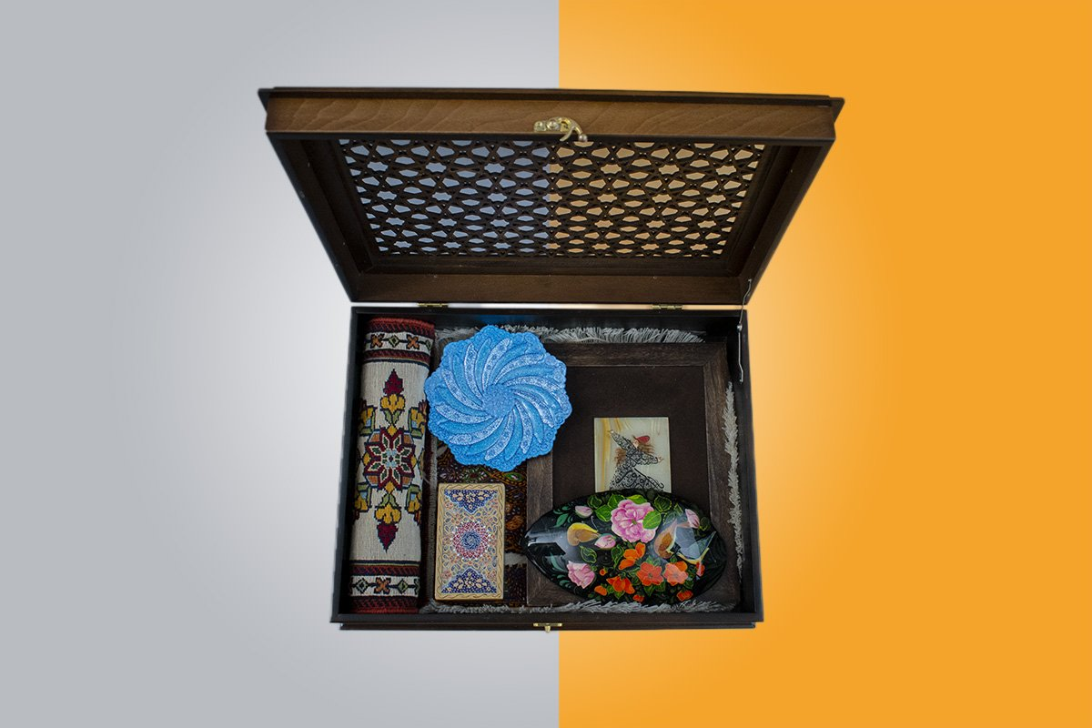 Craftestan Gift Box Consists Of Six Precious Persian Handicrafts. Including A Plate, A Jewellery Box, A Painting On Marble, Persian Tapestry And Miniature Persian Kilim. All The Artwork Is In A Wooden Chest Which Is Craved The Arabesque Reticular Windows.