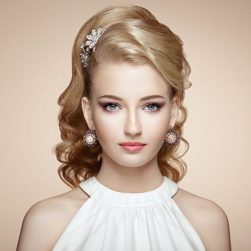 Fashion portrait of young beautiful woman with elegant hairstyle and Persian Balochi embroidery earring - Floral Circle