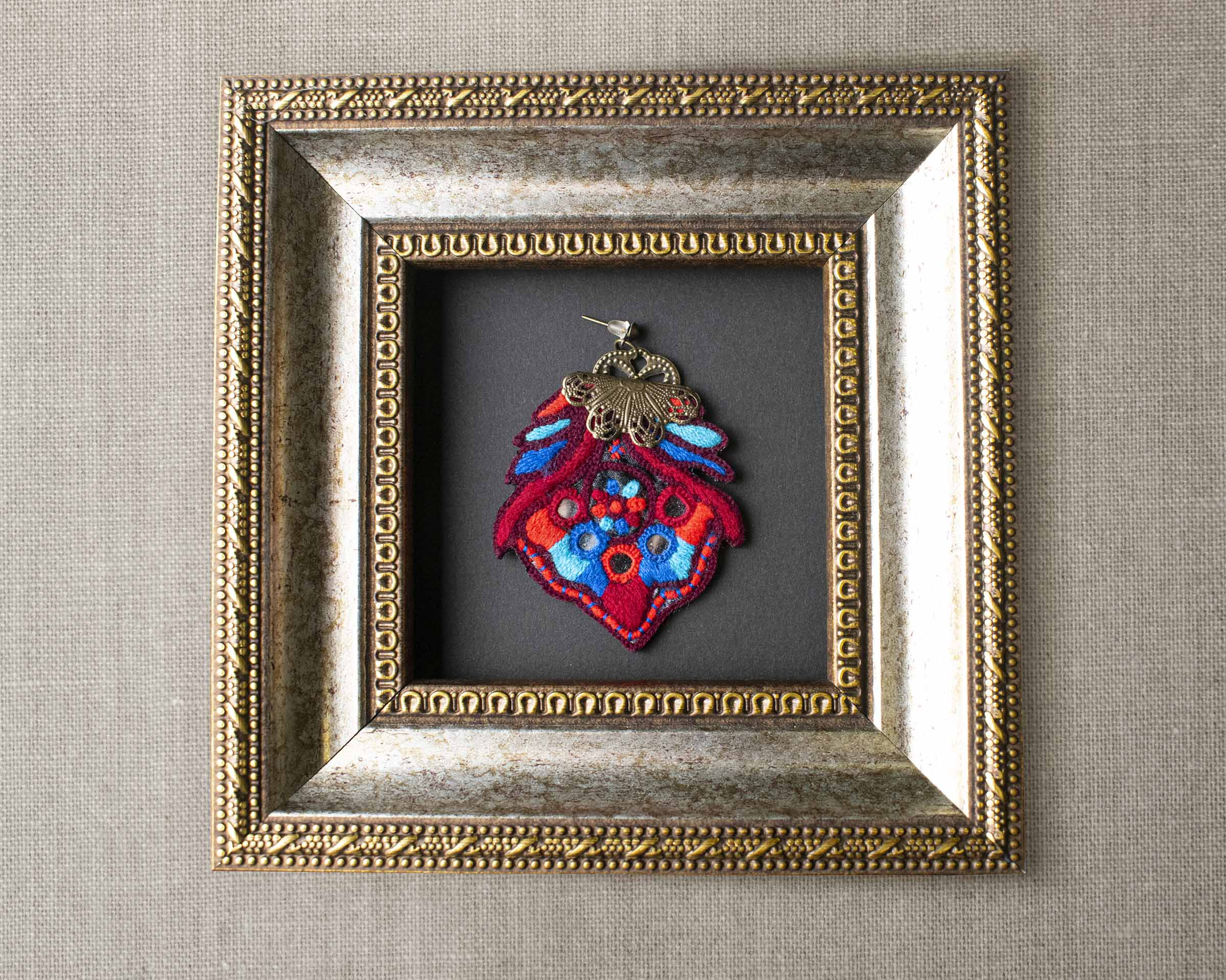 Persian Balochi embroidery earring, flower shape with several tiny mirrors