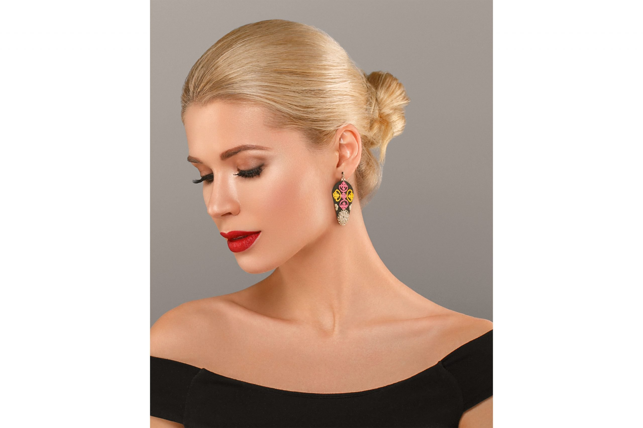 Woman nail manicure lipstick same color beauty portrait with Persian Balochi embroidery earring