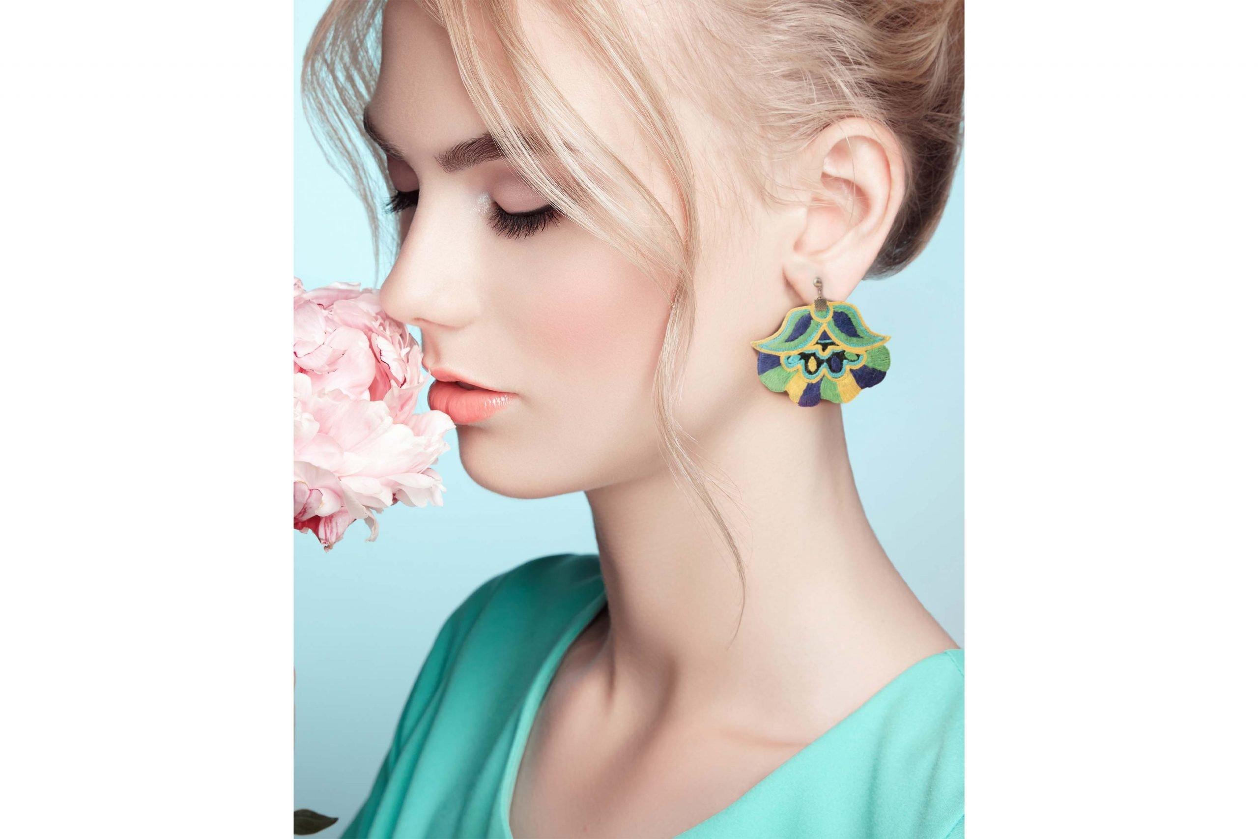 Portrait of beautiful sensual woman with elegant Persian Balochi embroidery earring
